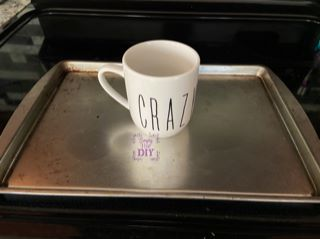 put glass mug on a tray to be able to heat set chalk couture ink on glass