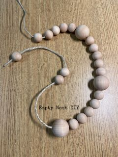 wood bead garland made with wooden beads and string.